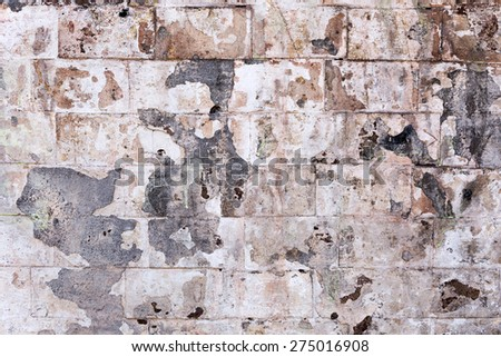 Abstract background old white brick wall with cracks and scratches. Landscape style. Great background or texture. - stock photo