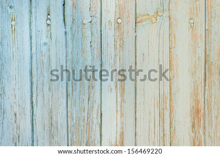 Abstract background - Old wooden planks with cracked light blue paint in daylight - stock photo