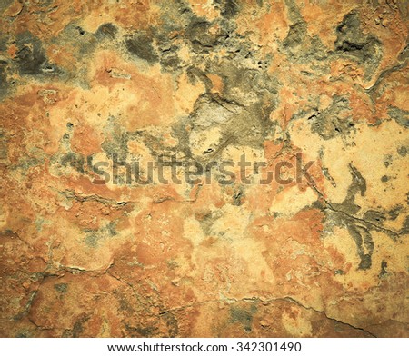 abstract background or texture old sand plaster ocher paint
