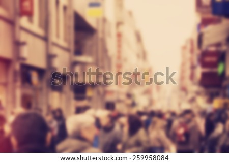 Abstract background - people shopping and walking in main shopping street in Cologne, Germany - blur effect defocusing filter applied, with vintage instagram look. - stock photo