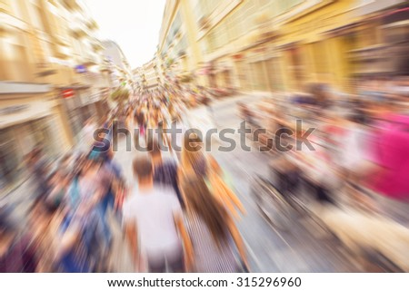 Abstract background - people shopping and walking in main shopping street in Nice, France - lens zoom blur effect defocusing filter applied, with vintage instagram look. - stock photo