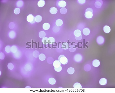 Abstract background purple bokeh circles. Defocused silver lights. Festive blur background. - stock photo