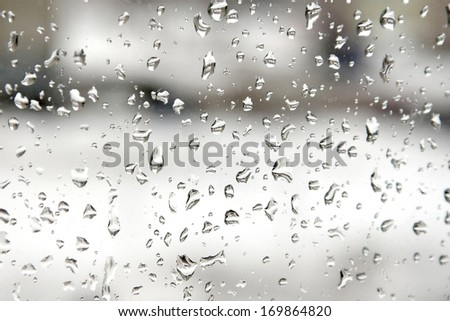 Abstract background. Rain drops on the window. Shallow DOF. - stock photo