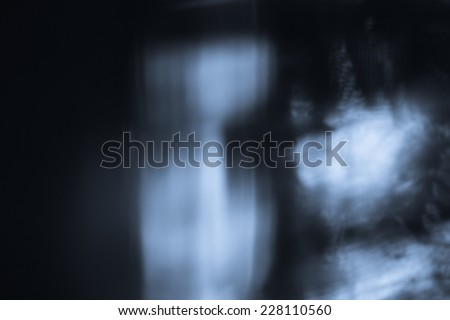 Abstract background. Shadows of the curtain moves on the wall - stock photo