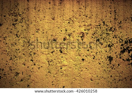 Abstract background texture cement wall in orange yellow tone. Grunge wall. Cement texture and background with copy space for text or image. Dark edged. - stock photo