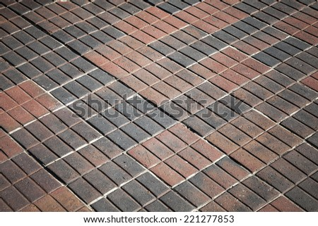 Abstract background texture of modern red cobblestone road pavement
