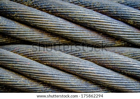 Abstract Background Texture Of OIly Industrial Twisted Steel Cables - stock photo