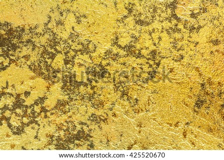 Abstract background texture of stone wall in yellow gold tone. Grunge wall. Cement wall texture and background with copy space for text or image. - stock photo