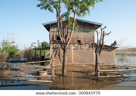 Abstract Background Texture of water level stain pattern after flood on wall house, Thailand - stock photo