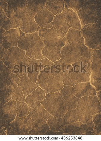 Abstract background textured in golden sepia tones with bright cracks.