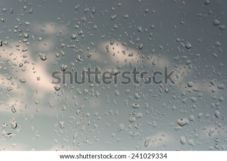 Abstract background, water drops on a window glass, rainy day - stock photo