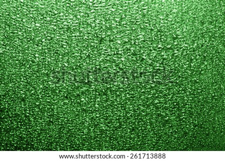Abstract background - water drops on green glass or metal