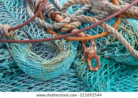 Abstract background with a pile of fishing nets ready to be cast overboard for a new days fishing - stock photo