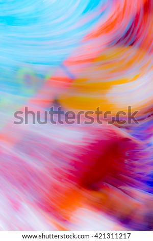 Abstract background with blurred flowing water mixed with oil