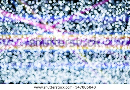 abstract background with bokeh lights and laser beam. - stock photo