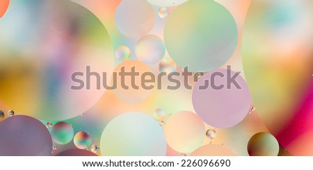 abstract background with bright colors, oil drops on water - stock photo