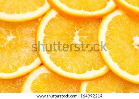 Abstract background with citrus fruit of orange slices. Close up. - stock photo