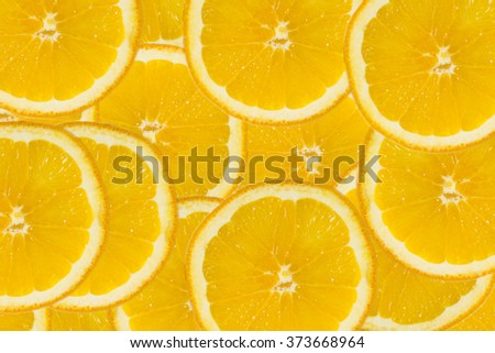 Abstract background with citrus-fruit of orange slices. Close-up. Healthy food background. Studio photography.