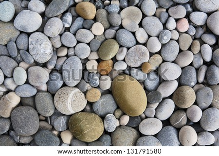 abstract background with dry round reeble stones - stock photo