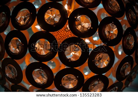Abstract background with glass crystal shaped design elements of modern chandelier