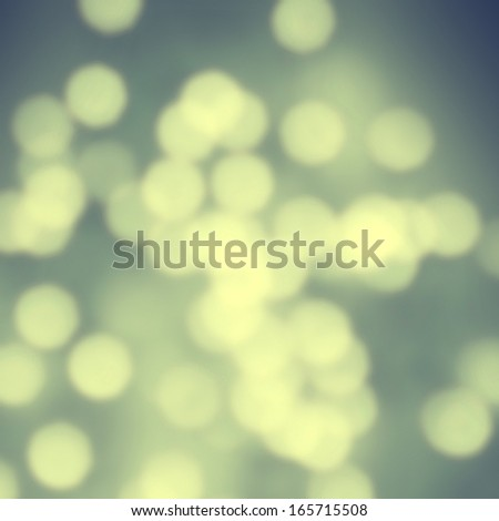 Abstract  background with glowing magic bokeh, defocused holiday lights with copyspace, party background. - stock photo