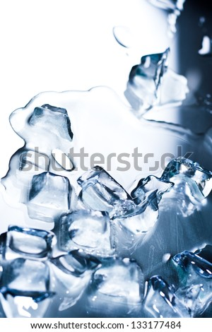 Abstract background with ice cubes over wet glass - stock photo