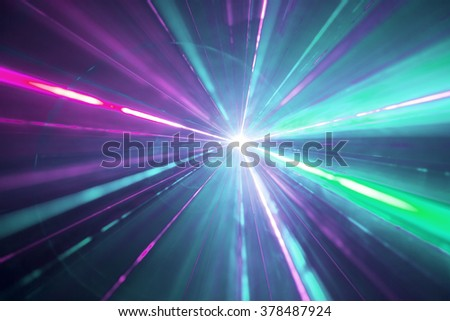 Abstract background with lights burst. Laser lights and fog. Party lights
