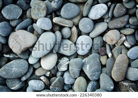 Abstract background with pebbles - round sea stones - stock photo