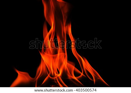 Abstract background with red flames iosalted on black background,close,horizontal view. - stock photo