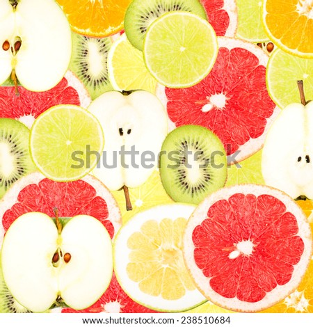 Abstract background with slices of fresh fruits. Seamless pattern for a design. Close-up. Studio photography. - stock photo