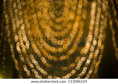 Abstract background with soft focus light , beautiful golden bokeh on black background