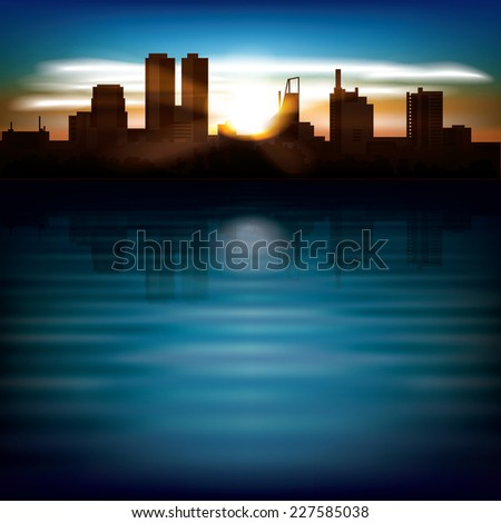 abstract background with sunrise and silhouette of city - stock photo
