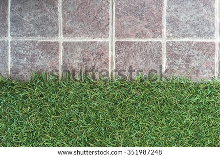 Abstract background with tiles and artificial grass floor - stock photo