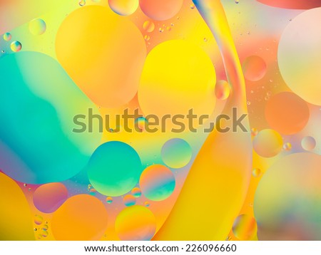 abstract background with vibrant colors, oil drops on water - stock photo