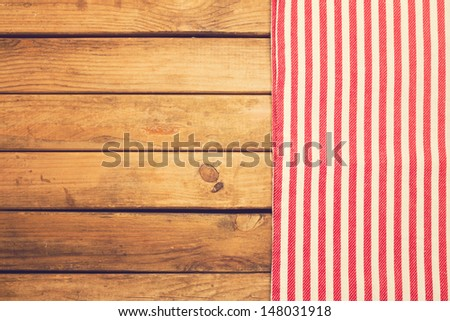 Abstract background with wooden table and tablecloth - stock photo