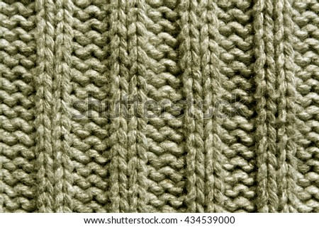 Abstract beige knitting texture close-up. Background and texture for design. - stock photo