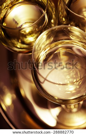 Abstract beverage. Drinks on the tray. Shallow depth of field. - stock photo