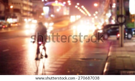 abstract bike on colorful street light at night in the city, soft and blur concept - stock photo