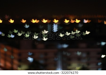 Abstract bird-bokeh background from city light. - stock photo
