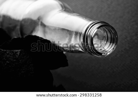 Abstract black and white background design made from glasses and or bottles. - stock photo