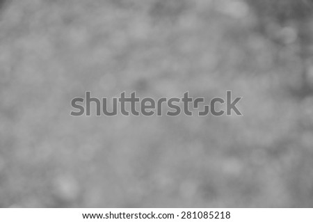 Abstract black and white bokeh background - stock photo