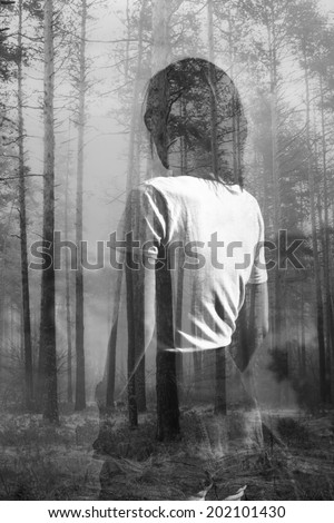 Abstract black and white double exposure portrait of woman in forest - stock photo