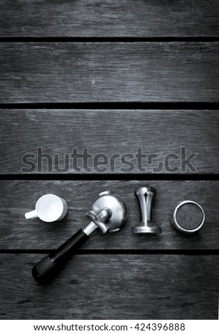 Abstract black and white tone espresso equipments on wood background, vertical style - stock photo