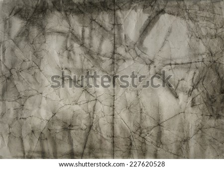 abstract black ink painting on crumpled paper - stock photo