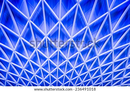 Abstract blue architecture of a ceiling at London King's Cross train station - stock photo