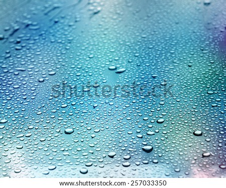 Abstract blue background. Liquid on dirty glass. (selective focus) - stock photo