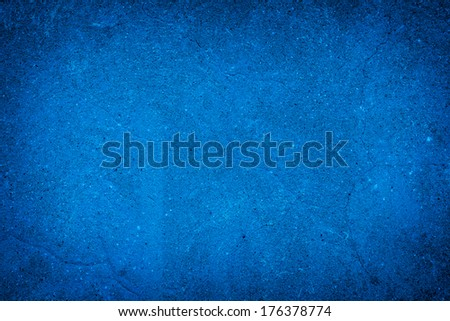 abstract blue background of elegant dark vintage grunge texture black on border with light center blank for luxury brochure invitation ad or paper art canvas paint layout - stock photo