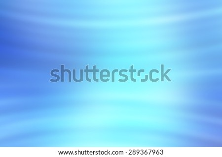 Abstract blue background with bokeh defocused lights and shadow.