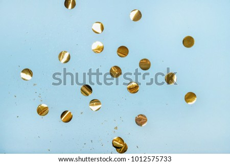 Abstract blue background with golden confetti. Top view. Flat lay
