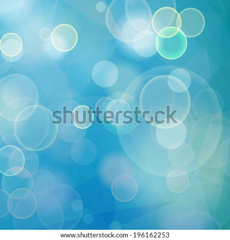 Abstract blue bokeh geometric background with bubbles and triangular polygons
